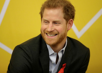 Britain's Prince Harry visits the Terrence Higgins Trust charity's HIV self-test pop-up shop in Hackney, London