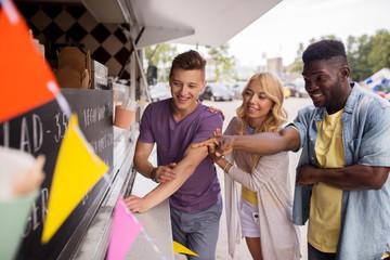 customers or friends choosing menu at food truck