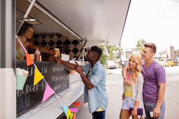 happy customers queue at food truck