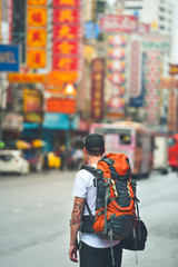Man with a backpack in chinatown, bangkok, thailand