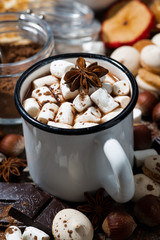 hot chocolate with marshmallows and sweets, vertical closeup
