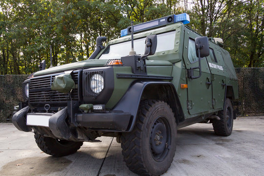 german armored military police vehicle stands on platform