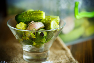 Pickled cucumbers in a glass bowl
