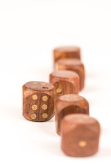 Selective focus on wooden gambling dice with individuality concept