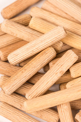 Pile of wooden dowels isolated on white background