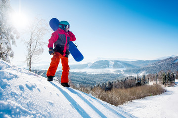 Full length shot of a snowboarder standing on top of the mountain looking away resting after riding copyspace nature relaxation recreation sports lifestyle active people concept