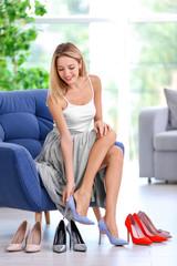 Woman choosing shoes at home