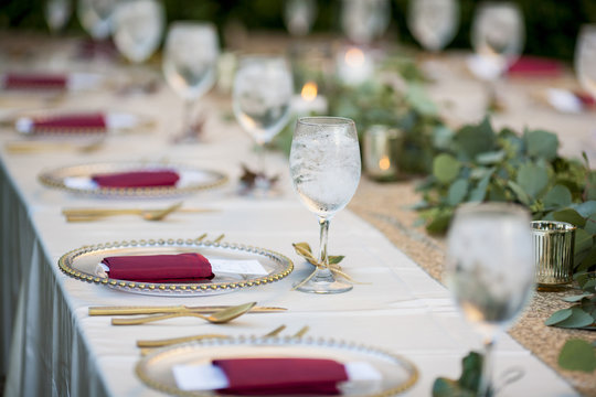 Elegant table set up for dinner for either wedding reception or Christmas.