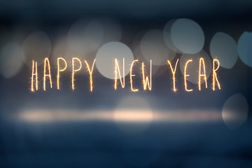 Happy New Year sprkler light on Aabstract bokeh background.