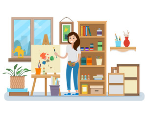 Art studio interior. Woman artist drawing.