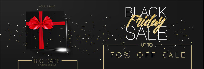 Black friday sale cardboard box tied with a black ribbon bow and lying on a black background with confetti and inscription Black friday Top view Template for the wide poster, banner and web