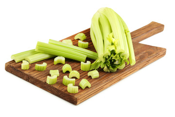 Celery on cutting board isolated on white