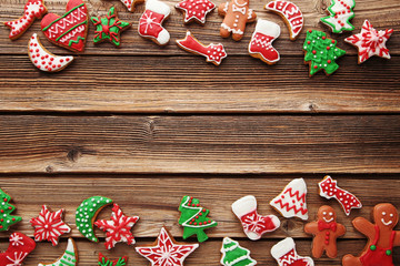 Christmas gingerbread cookies on brown wooden table