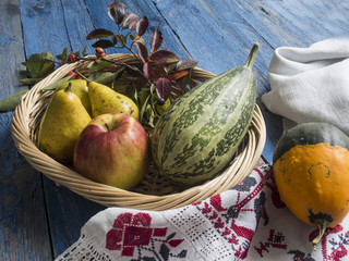 Pears, apples and pumpkins in a basket