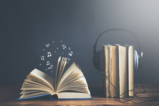 open musical notes book with earphone