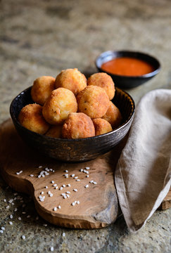 Arancini - traditional deep fried rice balls with meat and cheese