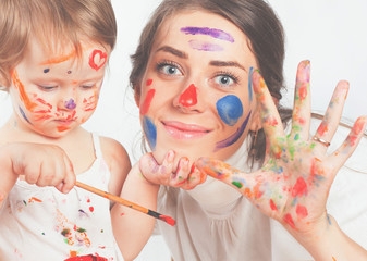 Mom and baby draws with colored inks