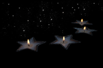 Christmas candles on starry sky