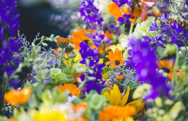 Bright bouquets of flowers at open air farmer's market