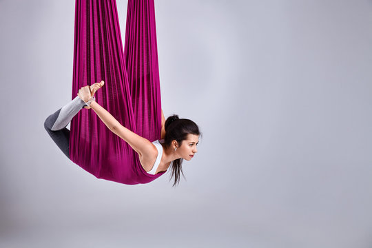Aerial different inversion yoga in a hammock