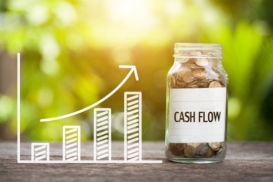 Cash Flow Word With Coin In Glass Jar and graph up. Financial Concept