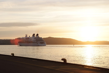 Passenger ship in sunset sea in Bergen, Norway