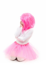 Childhood and happiness. Child in wig isolated on white background. beauty and fashion. Small girl t in pink skirt. ballet and art.