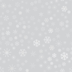 seamless pattern from white snowflakes on the grey background. Texture for cards, greeting, Christmas, new year, holiday, party