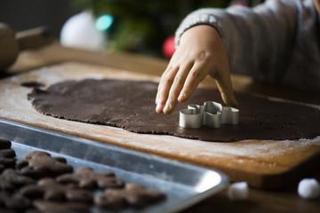 Kid making Christmas cookies