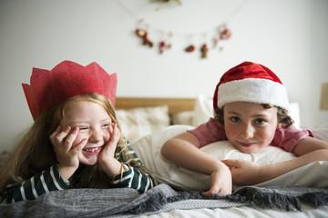 Caucasian kids enjoying Christmas holiday