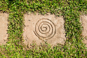 Spiral on Square Stone as a paving with grass in the garden