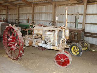 Antique tractors in an old barn