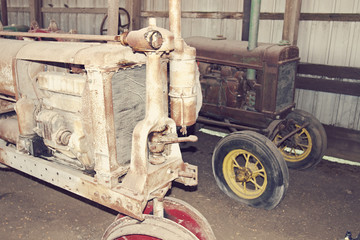 Old tractors in a barn
