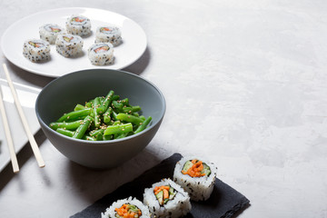 Japanese sushi and green beans on a white background