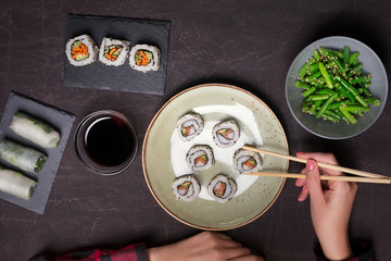 Japanese sushi and green beans on a black background