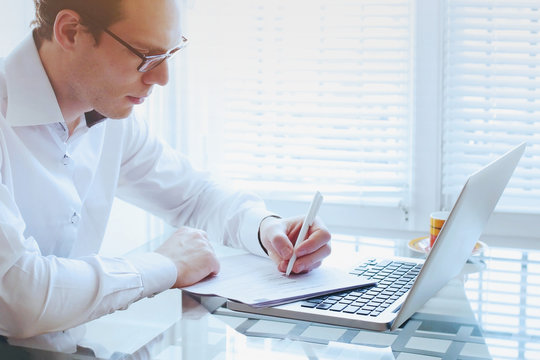 business man working in the office with computer and documents