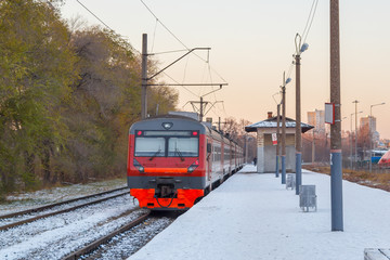 Electric train awaits passengers on the platform