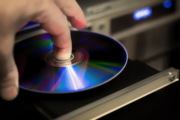 DVD disc inserting to player