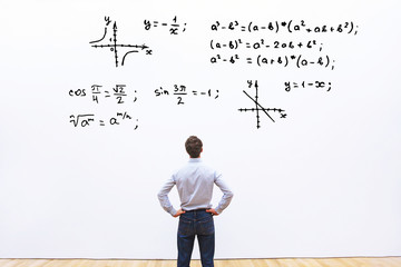 student looking at mathematical formulas, learn maths education concept