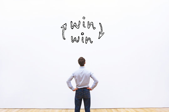 win-win concept, business man looking at win situation sign
