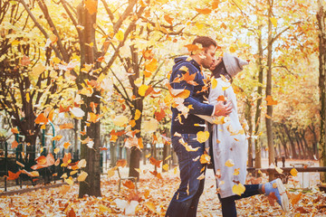 autumn love, couple kissing in fall park, happy man and woman outside