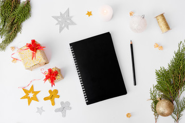 diary notebook stylish mock up for christmas time. christmas tree, cones and decorations on white background.