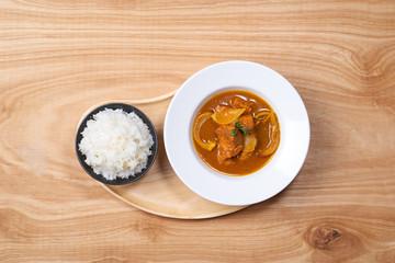 Chicken curry in a bowl / Vietnam chicken curry on wooden background