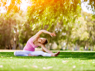 Young woman doing yoga in the park