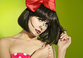 Funny mime girl with a red bow