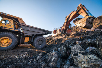 type of coal mine with working excavators and large cars