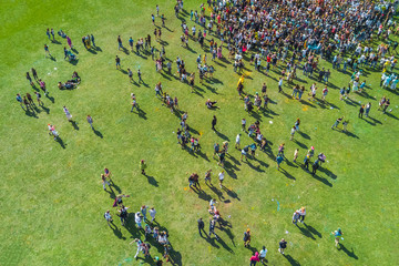 Top view of the people are stained in colorful paints holi