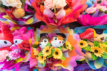 bunches of cute soft toys with flowers