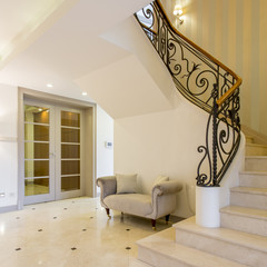 Light hallway with beautiful staircase