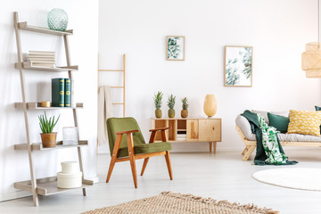 Relax room with green armchair
